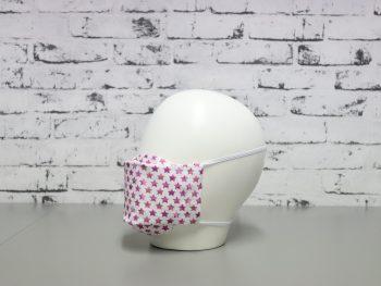 mascarilla lavable blanca con estampado de estrellas rosa